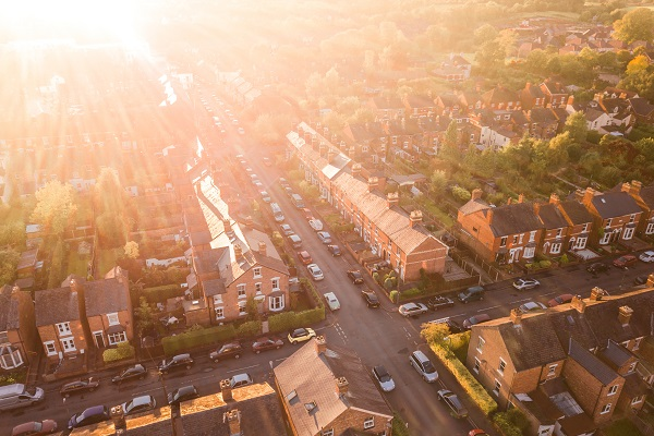 birds eye view of a british town with homes and cars