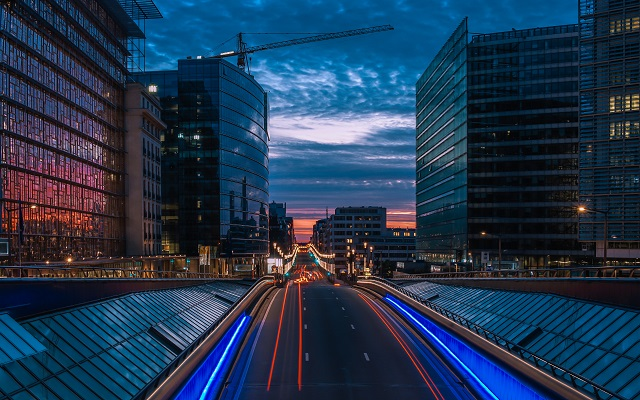 brussels at night with eu institution buildings - belgium - ev charger incentives guide - wallbox