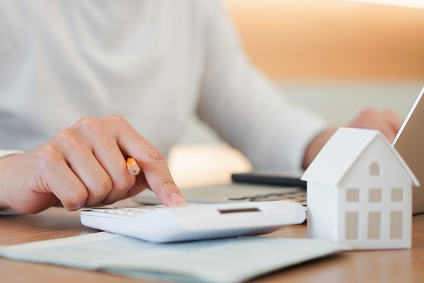 homeowner calculating the costs of enabling electric vehicle charging in condominiums