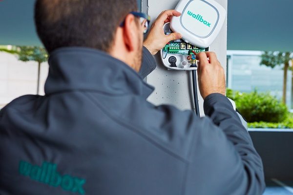 certified installer installing an ev charging station in a condo - wallbox