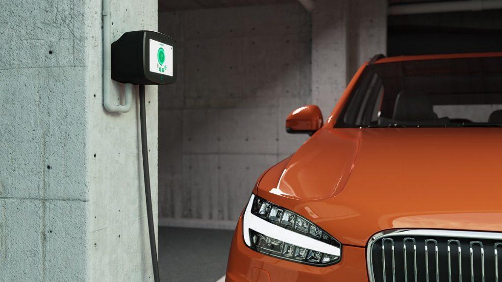 Wallbox ev charger in condo with orange ev