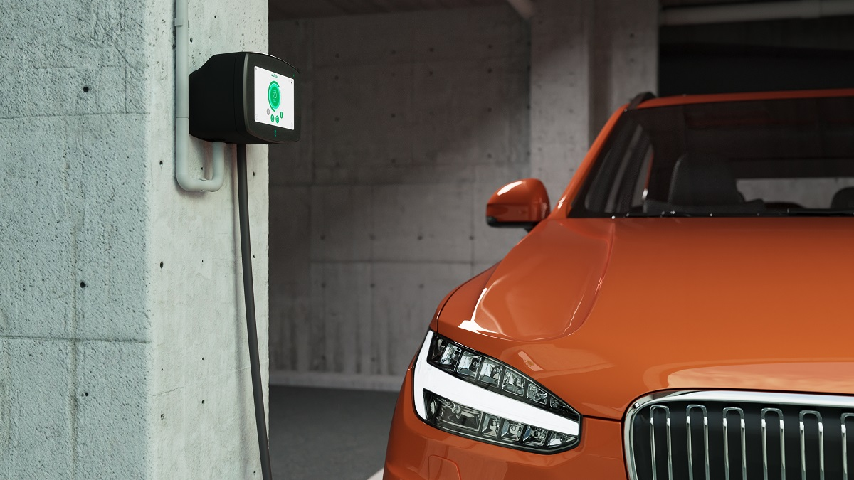 Wallbox ev charger in condo with orange ev